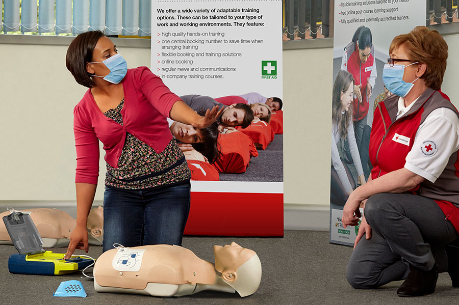 first aid at work with masks